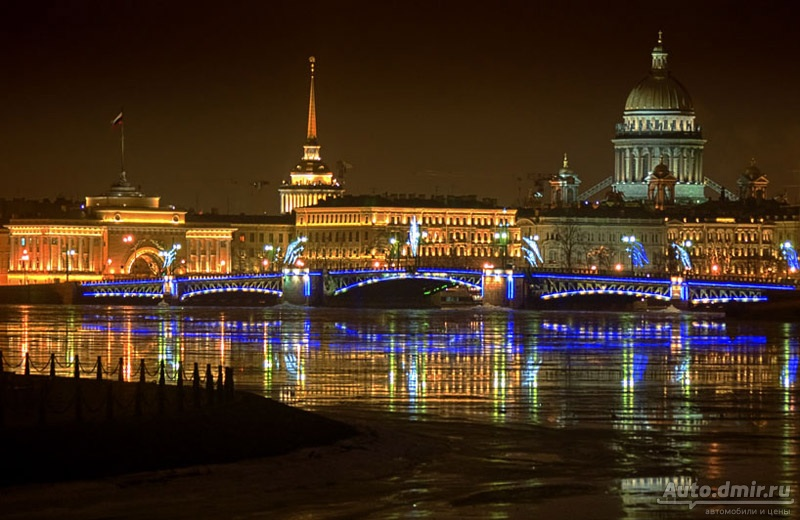 The Palace bridge in the waters of the Neva Majestic architectural ensembles